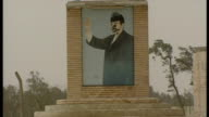 Exterior shots defaced and damaged mural of Saddam Hussein at the start of the 2003 Invasion of Iraq on March 26 2003 in Umm Qasr Iraq
