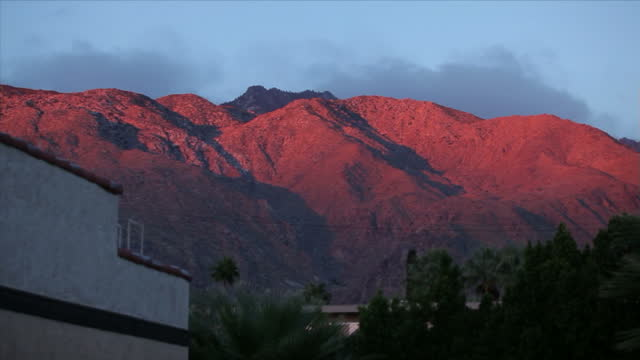 Exterior shots desert mountains and hills overlooking Palm Springs with sunset casting a reddish glow over the mountains on 7th November 2010 in Palm...