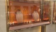 Exterior shots diamond emerald necklaces and rings in Bulgari BVLGARI store window on Bond Street luxury jewelry and goods store on Bond Street on...