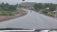 Exterior shots driveby views of Liberian countryside and small towns including crashed bus in rainy weather on July 2nd 2014 in Foya Liberia