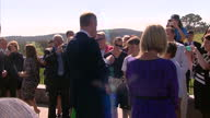 Exterior shots Duke and Duchess of Cambridge accepting flowers from young boy