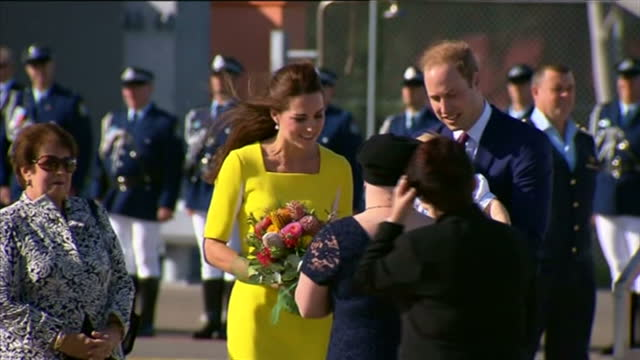 SYDNEY exterior shots Duke and Duchess of Cambridge exit plane carrying Price George walk down stairs and are greeted by officials