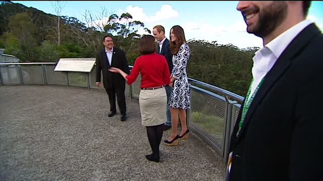 exterior shots Duke and Duchess of Cambridge pose for cameras on viewing platform with Blue Mountains in background
