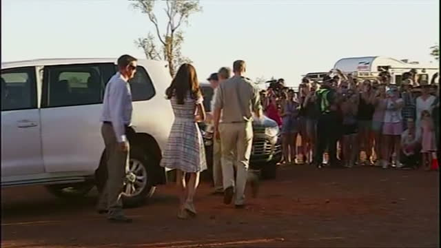 exterior shots Duke and Duchess walk together pause to speak to official get into waiting car and depart
