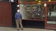 Exterior shots Dunblane preparations ahead of Andy Murray and Kim Sears wedding including good luck message on shop front and Andy Murray's gold...