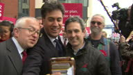 Exterior shots Ed Miliband Labour Party leader meeting supporters taking selfie photo with party activists during campaign event in Ipswich outside...
