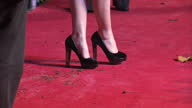 Exterior shots Emma Watson poses on the red carpet at the premiere of Harry Potter the Deathly Hallows in Leicester Square Emma Watson at the Harry...