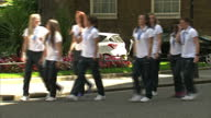 Exterior shots England Women's Football team arrive at Downing Street on coach walk up street and enter Number 10 Downing Street on July 09 2015 in...
