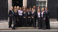 Exterior shots England women's football team posing for photo op outside 10 Downing Street on June 10 2011 in London England