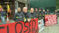 Exterior shots firemen walking out of station with banners into forecourt on July 10 2014 in UNSPECIFIED United Kingdom
