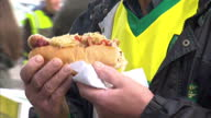 Exterior shots football fans eating fast food from burger vans outside football ground before match Efforts made to reduced level of saturated fat on...