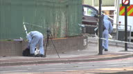 Exterior shots forensic police officers near crime scene on John Wilson Street the A205 in Woolwich after a soldier was attacked by two men with...