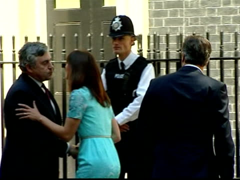 Exterior shots former Prime Minister Gordon Brown his wife Sarah greet David Samantha Cameron outside Number 10 Downing Street all pose for photo...