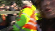 Exterior shots fracking protesters walking in front of police on March 11 2014 in Eccles England