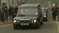 Exterior shots funeral cars procession with the coffin of Sir Jimmy Savile in the rear of hearse parade through Scarborough Jimmy Savile Funeral...