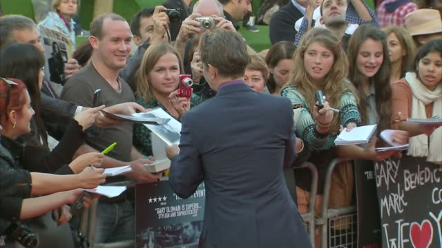 Exterior shots Gary Oldman walks on the red carpet signs autographs for fans Gary Oldman on the Red Carpet at Premiere on September 13 2011 in London...