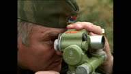 Exterior shots General Ratko Mladic being show BosnianSerb soldiers position at countryside base and looks through sights on September 01 1992 in...