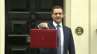 Exterior shots George Osborne Chancellor of the Exchequer outside 11 Downing Street holding red budget box up to the media on July 08 2015 in London...