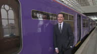 Exterior shots George Osborne Chancellor of the Exchequer unveils a new Northern Rail train called 'Northern Powerhouse' and poses next to train with...