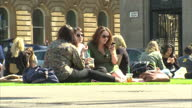 Exterior shots George Square in Glasgow Glasgow City Chambers people enjoying sunny warm weather in Glasgow on April 23 2015 in Glasgow Scotland