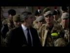 Exterior shots Gordon Brown delivering speech to gathered British servicemen
