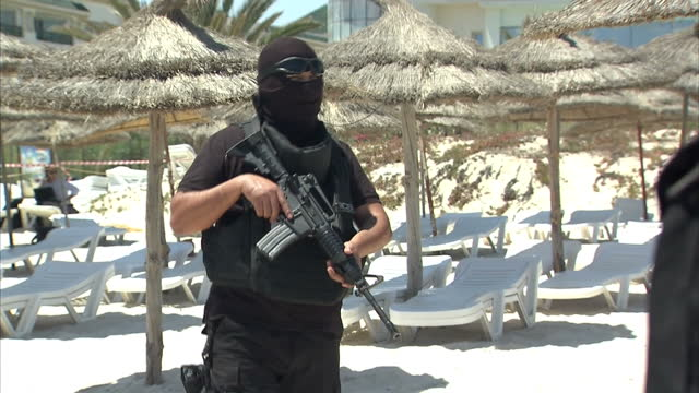 Exterior shots heavily armed security on Sousse beach for visit of Theresa May British Home Secretary Armed security keeping tourists and locals at...