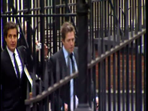Exterior shots High Grant arrives at the Leveson Inquiry with his legal team Hugh Grant Arrives for the Leveson Inquiry on November 21 2011 in London...