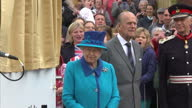 Exterior shots HM The Queen Elizabeth II and Prince Philip Duke of Edinburgh at Borders Railway opening ceremony Queen Elizabeth II unveiling plaque...