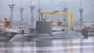 Exterior shots HMS Artful Royal Navy AstuteClass Submarine docked at Faslane Naval Base on January 22 2016 in Faslane Scotland