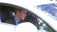 Exterior shots HRH Prince William Duke of Cambridge looking at Aston Martin Rapide S car outside Tustaya bookshop Prince William gets in drivers seat...