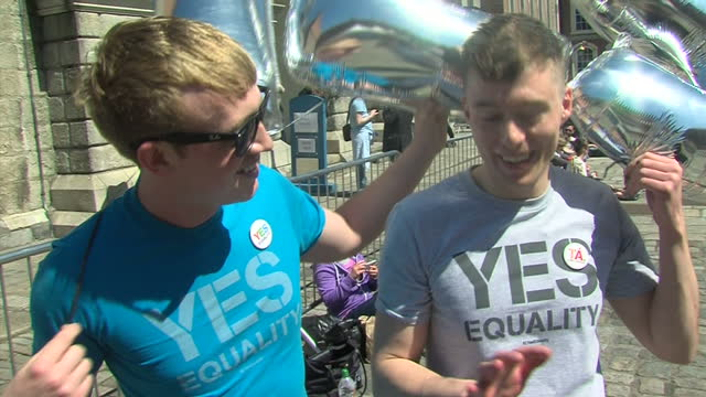 Exterior shots huge crowd at gay marriage rally waving rainbow flags Vox Populi Exterior Interviews Katheriner Zappone and Ann Louise Gilligan Couple...