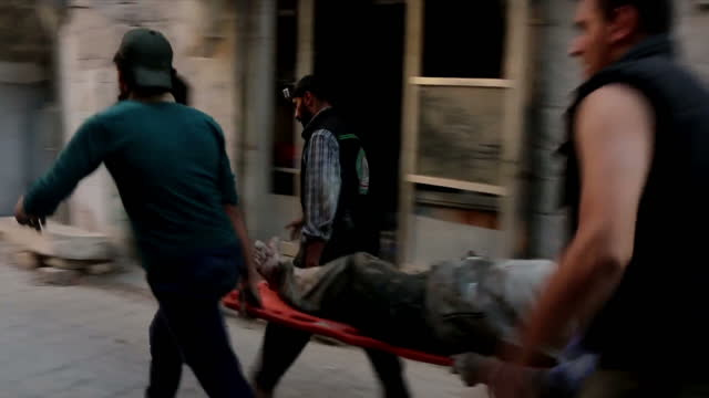Exterior shots injured people being carried on stretcher to ambulance on September 30 2016 in Aleppo Syria
