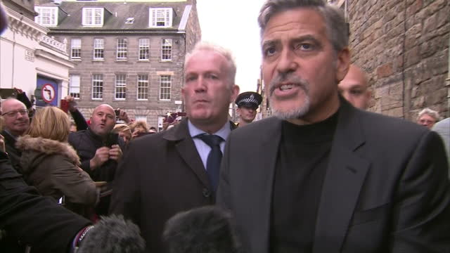 Exterior shots Interview soundbites with George Clooney actor on charity and what type of sandwich he's going to order George Clooney has paid a...
