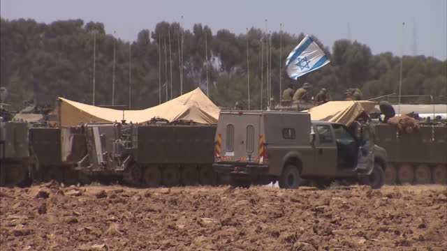 Exterior shots Israeli tanks stationed on the border with GazaIsrael Defense Force on July 12 2014 in Gaza City Gaza