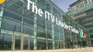 Exterior shots ITV Studios MediaCityUK with 'Leaders Debate' branding on front of building and media tents setup outside on April 02 2015 in...