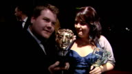 Exterior shots James Cordon actor now host of The Late Late Show on BAFTA red carpet with Ruth Jones holding BAFTA awards and talking to the media...