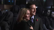Exterior shots Jason Isaacs his wife Emma Hewitt pose on the red carpet at the premiere of the Harry Potter the Deathly Hallows Jason Issacs on the...