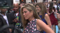 Exterior shots Jennifer Aniston talking to reporter pan out to show dress shoes worn on red carpet Jennifer Aniston On The Red Carpet on August 14...