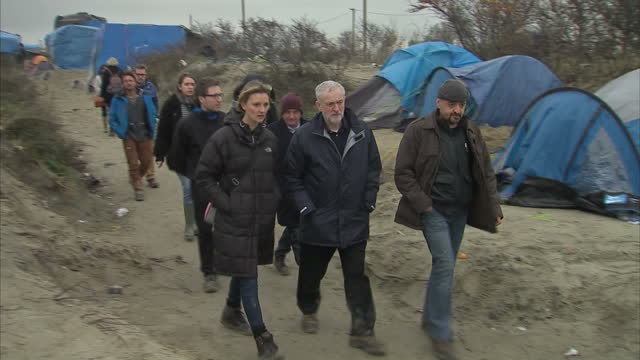 Exterior shots Jeremy Corbyn Labour Leader walking through migrant camp in Calais on January 23 2016 in Calais France