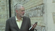 Exterior shots Jeremy Corbyn MP Labour leader candidate arriving at campaigning event Jeremy Corbyn talking on the phone holding bike as he arrives...