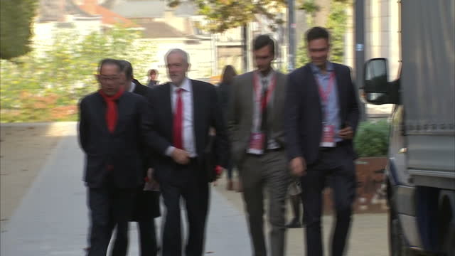 Exterior shots Jeremy Corbyn walks towards camera with officials during visit to Brussels for Brexit talks one man greets him as 'the future Prime...