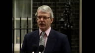 Exterior shots John Major Prime Minister departs Number 10 Downing Street walks to microphone 'I would like to formally confirm that I have seen Her...