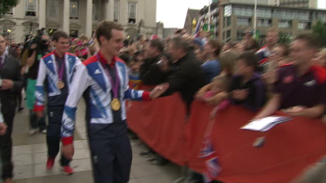 Exterior shots Jonathan Brownlee Alistair Brownlee with their Gold Bronze medals sign autographs wave to hundreds of fans at a welcoming event Large...