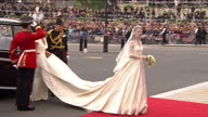 Exterior shots Kate Middleton gets out from Rolls Royce wearing a dress designed by Sarah Burton at Alexander McQueen with her sister Pippa holding...