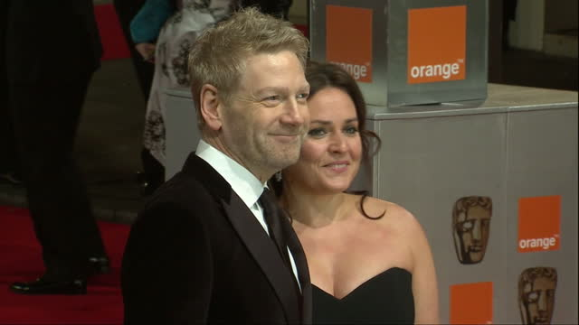 Exterior shots Kenneth Branagh poses on the red carpet with his wife Lindsey Brunnock at the BAFTA 2012 awards Kenneth Branagh Poses on the Red...