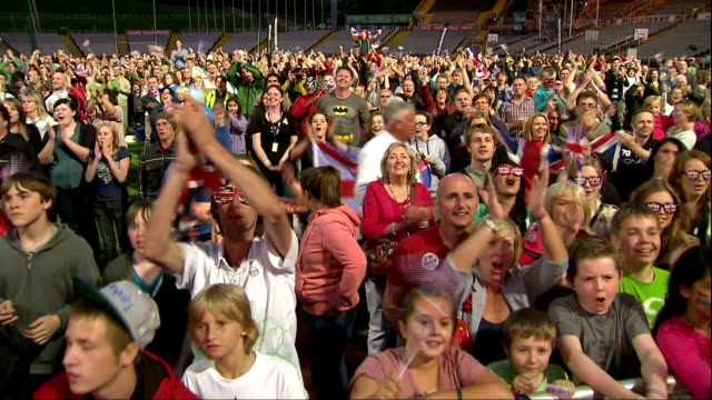 Exterior shots large crowd of fans in Sheffield cheers celebrate as Jessica Ennis wins Heptathlon gold Sheffield Fans React to Jessica Ennis Gold...