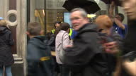 Exterior shots large crowds of fans customers queueing outside the London Apple store for the latest launch of the Iphone 5 Queues at the London...