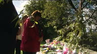 Exterior shots large display of floral tributes messages of sympathy laid on verge near to the pot where Police Officers Fiona Bone Nicolas Hughes...