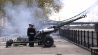 Exterior shots large guns being fired during salute in celebration of Queen Elizabeth's birthday Queen Elizabeth Gun Salute for Birthday on April 21...