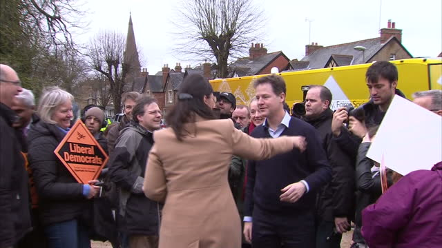 Exterior shots Liberal Democrat election bus arrives in front of Lib Dem supporters waving signs in support on March 29 2015 in Abingdon United...